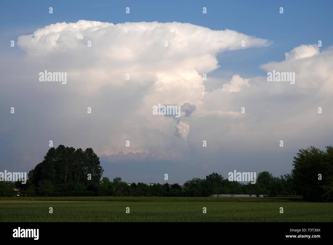 cumulonimbus, thunderstorm cloud over the plain - Stock Image