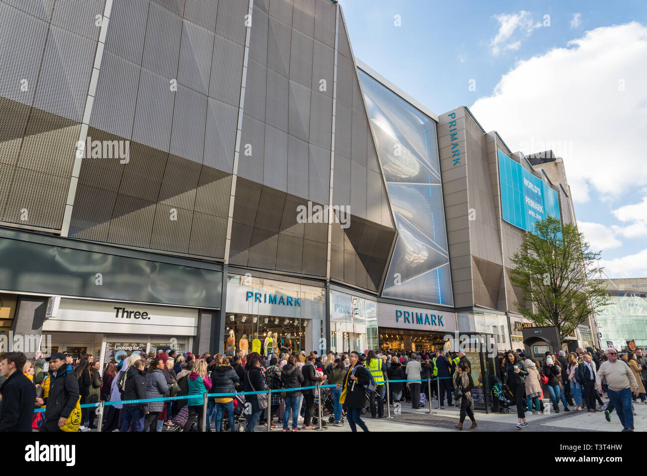 Crowds queuing outside the world's largest Primark store opened in Birmingham, UK on 11 April 2019. - Stock Image