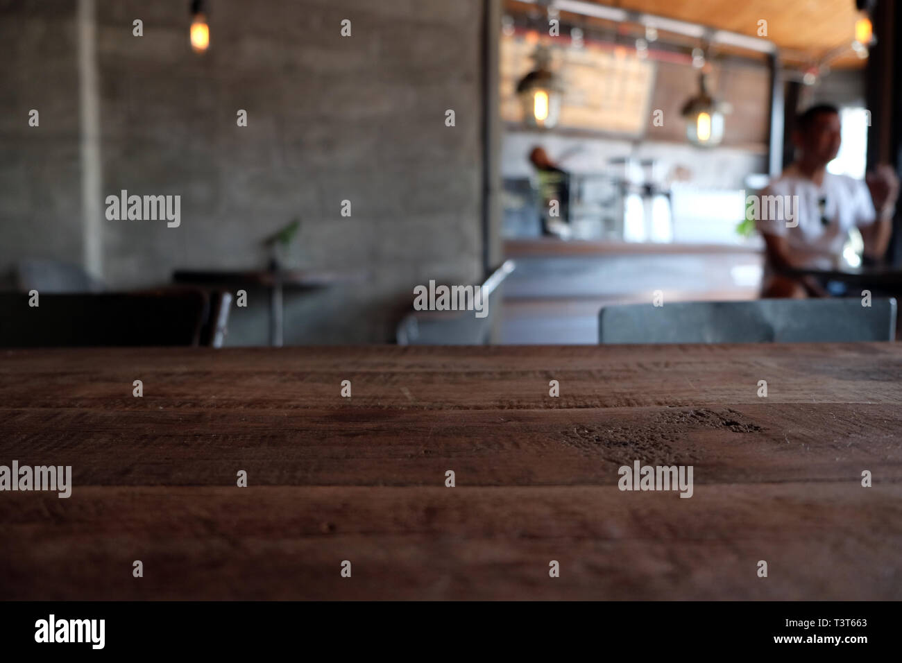Wood Table On Blur Of Cafe Coffee Shop Bar Resturant Background Can Used For Display Or Montage Your Products Stock Photo Alamy