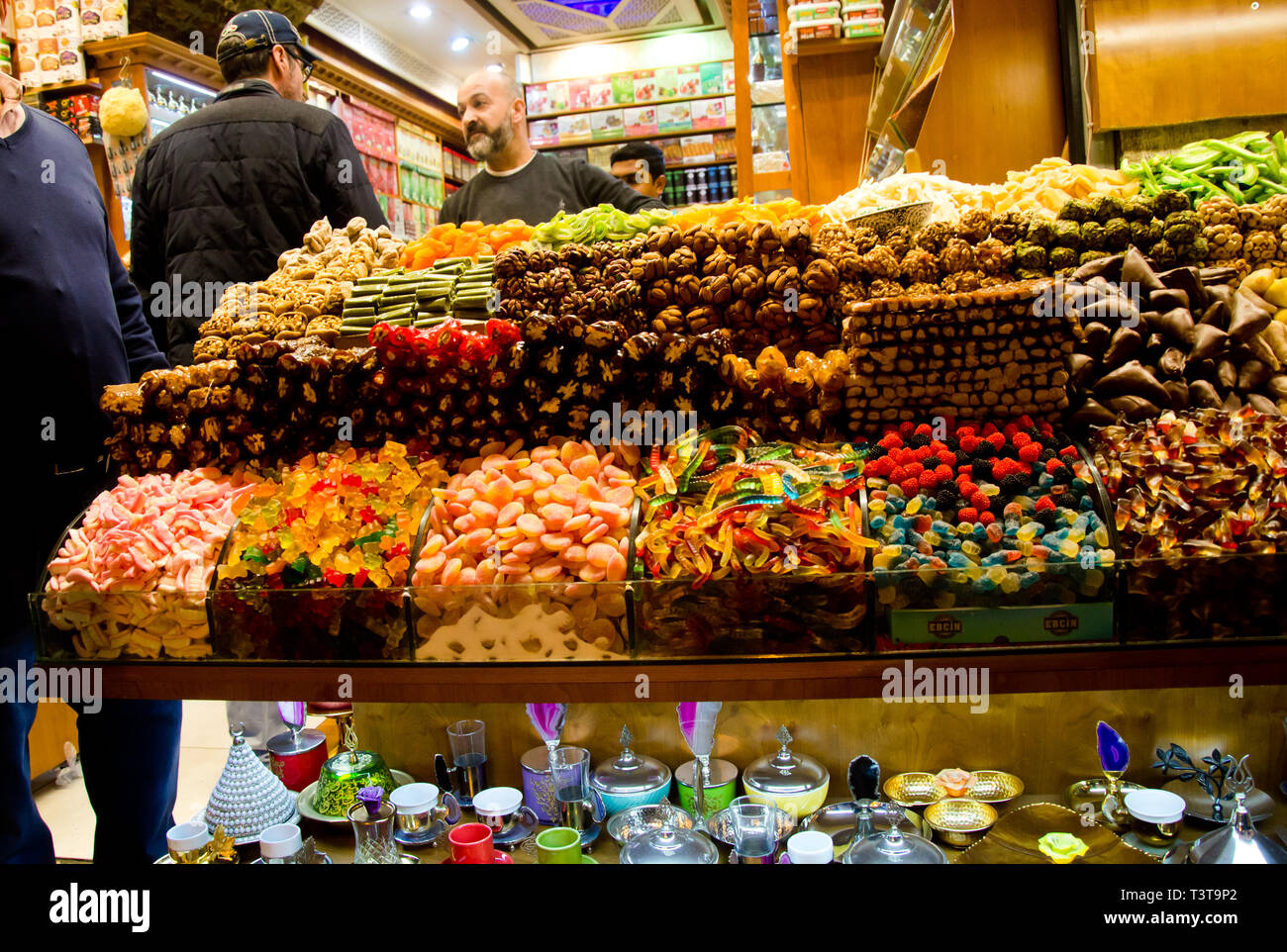 Istanbul,Turkey,March 07, 2019:inside of Egyptian Bazaar n front of store selling various colorful sweets, close up, with some customers inside - Stock Image