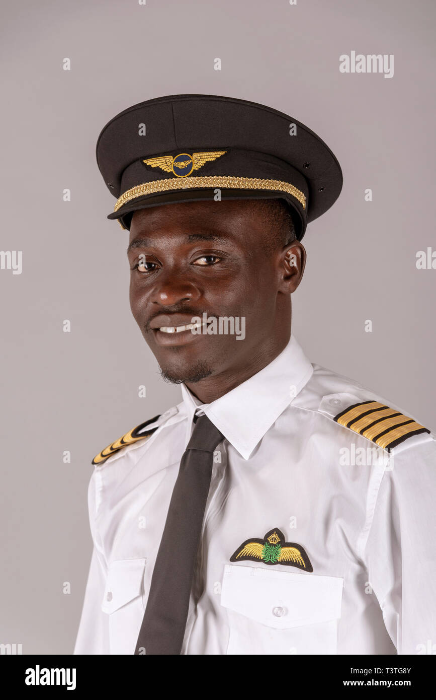 5d5287c064898 Portrait of a young airline pilot wearing a captain s uniform. - Stock Image