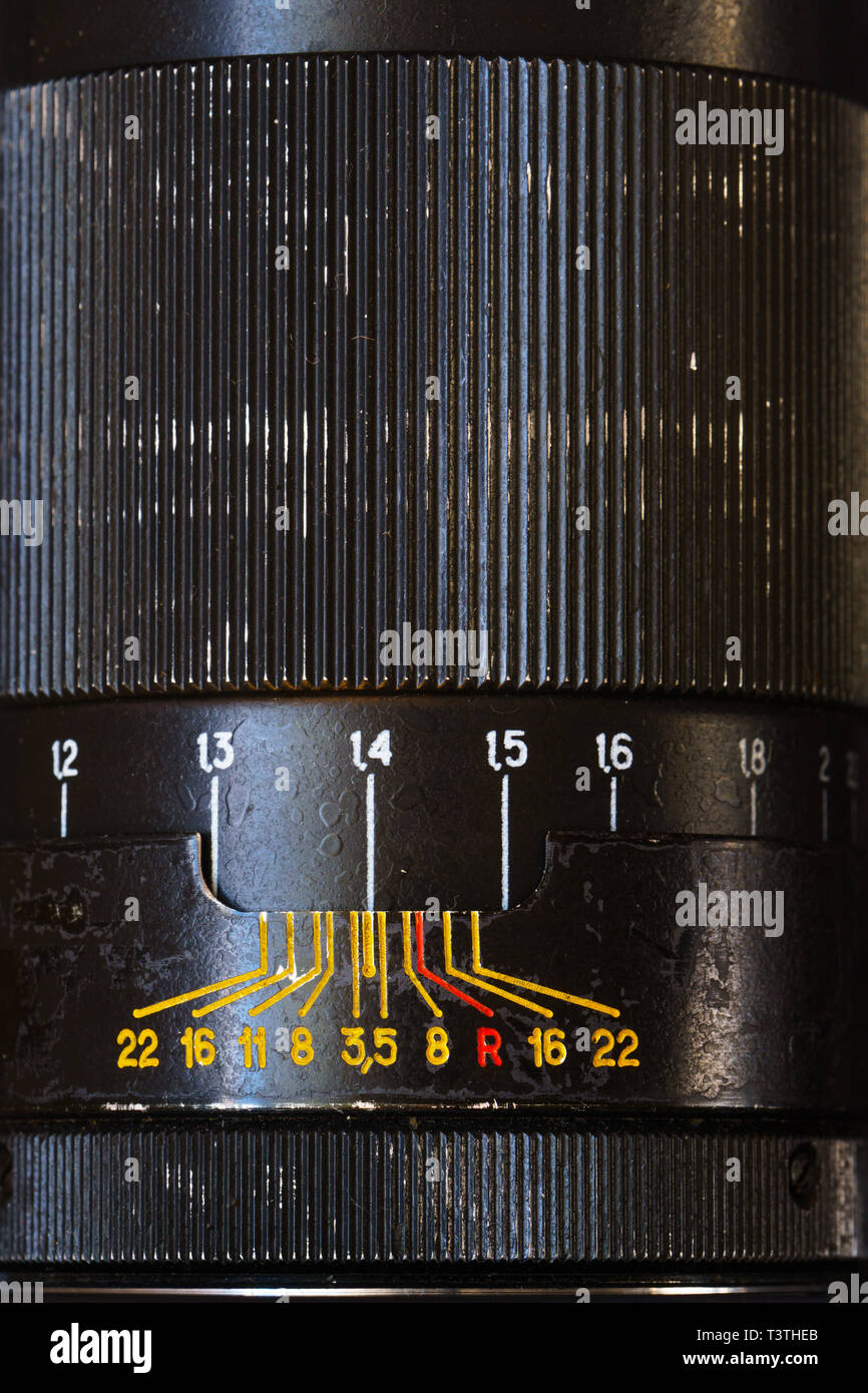 Close-Up View of Old Black Steel Lens from Film SLR Camera. - Stock Image