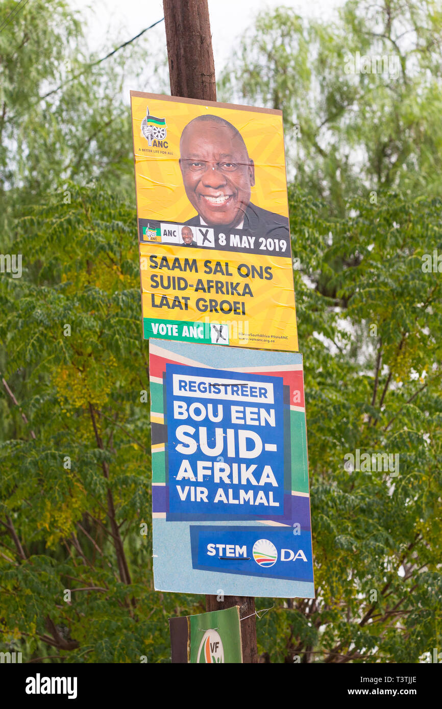 South Africa election posters of political parties on a pole in the town streets in Afrikaans - Stock Image