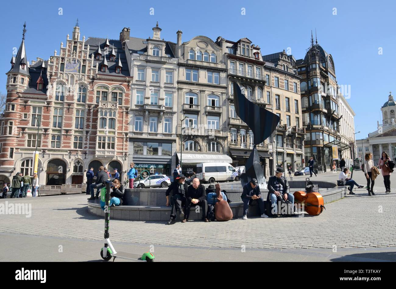Brussels, Belgium - March 29, 2019: Musicians in front of the Whirling Ear sculpture by Alexander Calder in square of Brussels, Belgium. - Stock Image