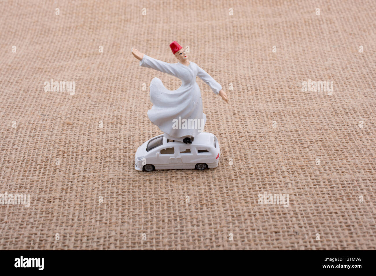 Sufi Dervish figurine model in small size in view - Stock Image