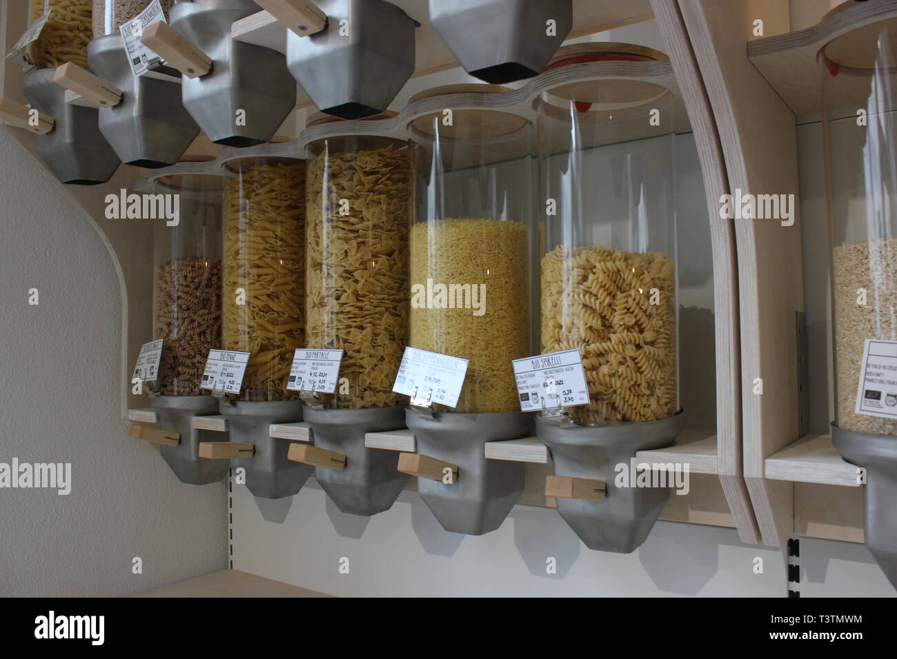 Pasta sold without packaging, presented in zero waste manner in glass containers. - Stock Image