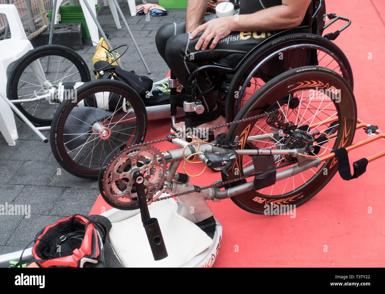 Disabled triathlete in transition area following swin leg of triathlon. - Stock Image