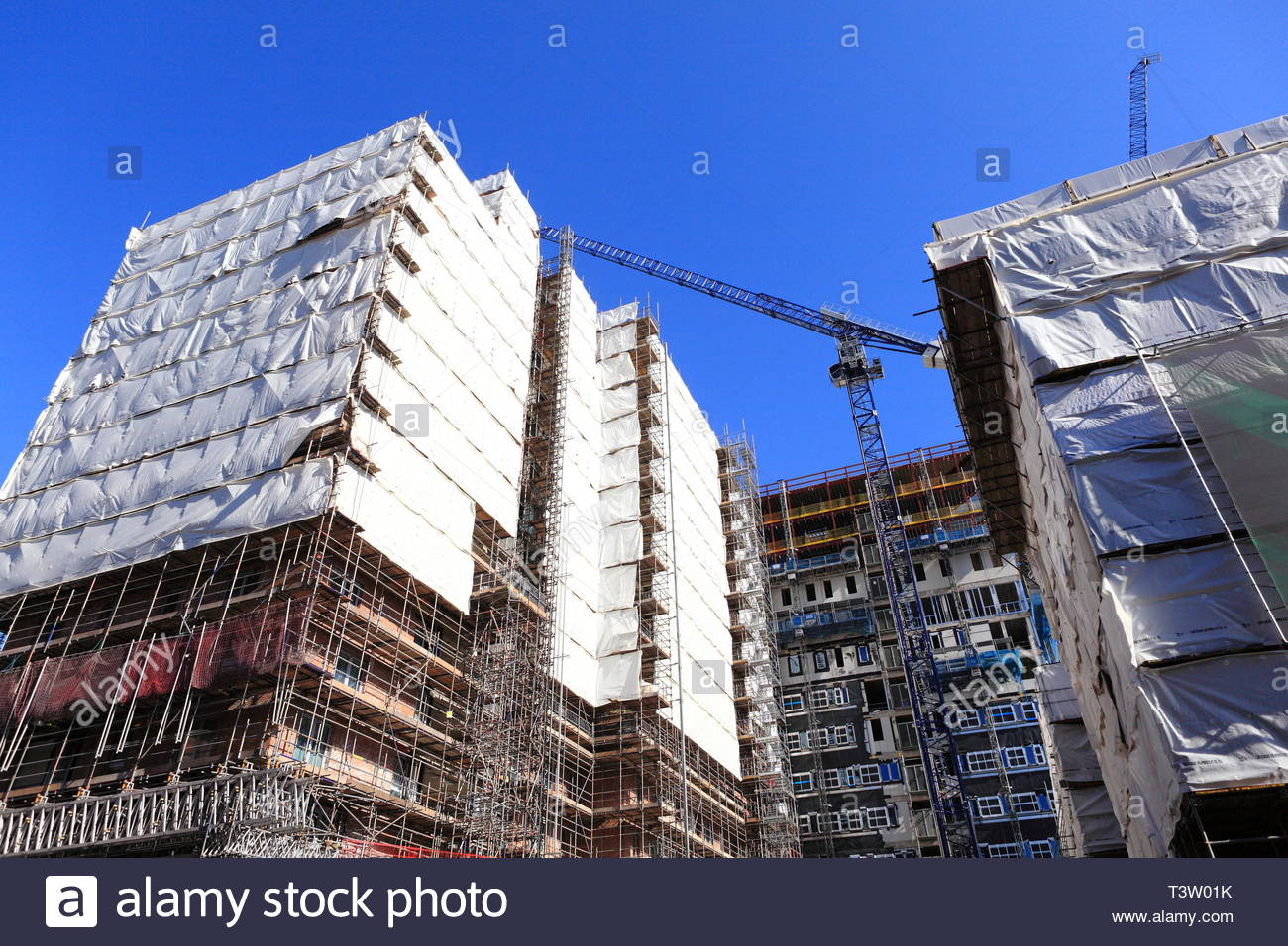 Construction site for luxury apartments with crane in background at Manchester UK - Stock Image