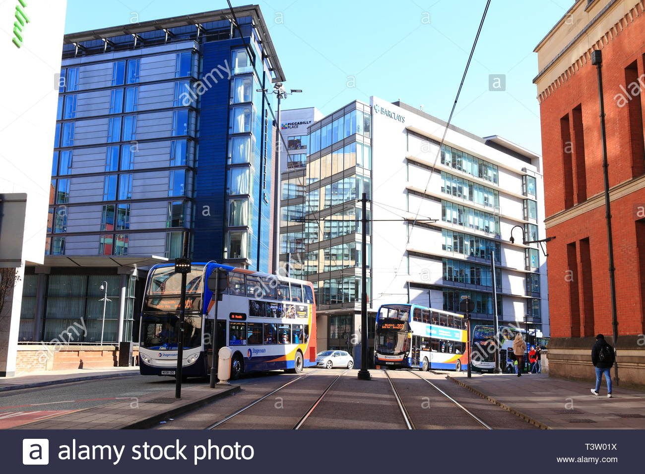 Tall architectural buildings under a clear blue spring sky at Manchester UK - Stock Image
