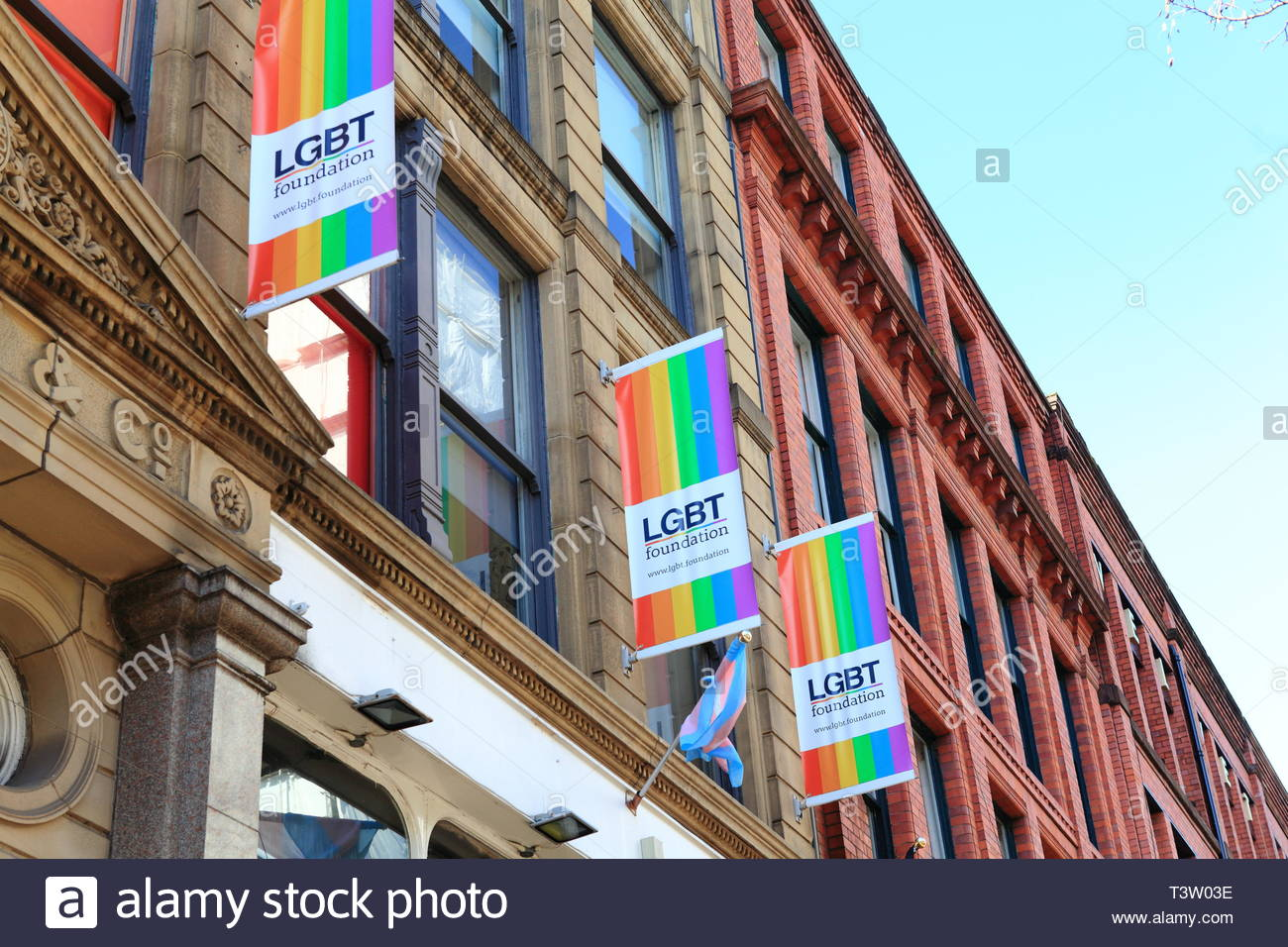 LGBT sign on stone wall at Canal Street at Gay Village Manchester UK - Stock Image
