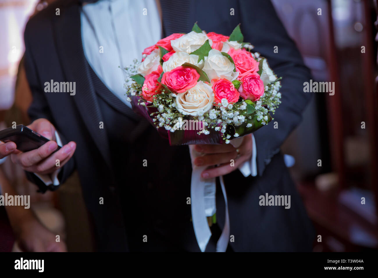 Man Holding A Beautiful Bouquet Of Tender And Colorful Flowers Tied With A Pretty Ribbon Groom Holding Wedding Bouquet Of White Roses Bridal Stock Photo Alamy