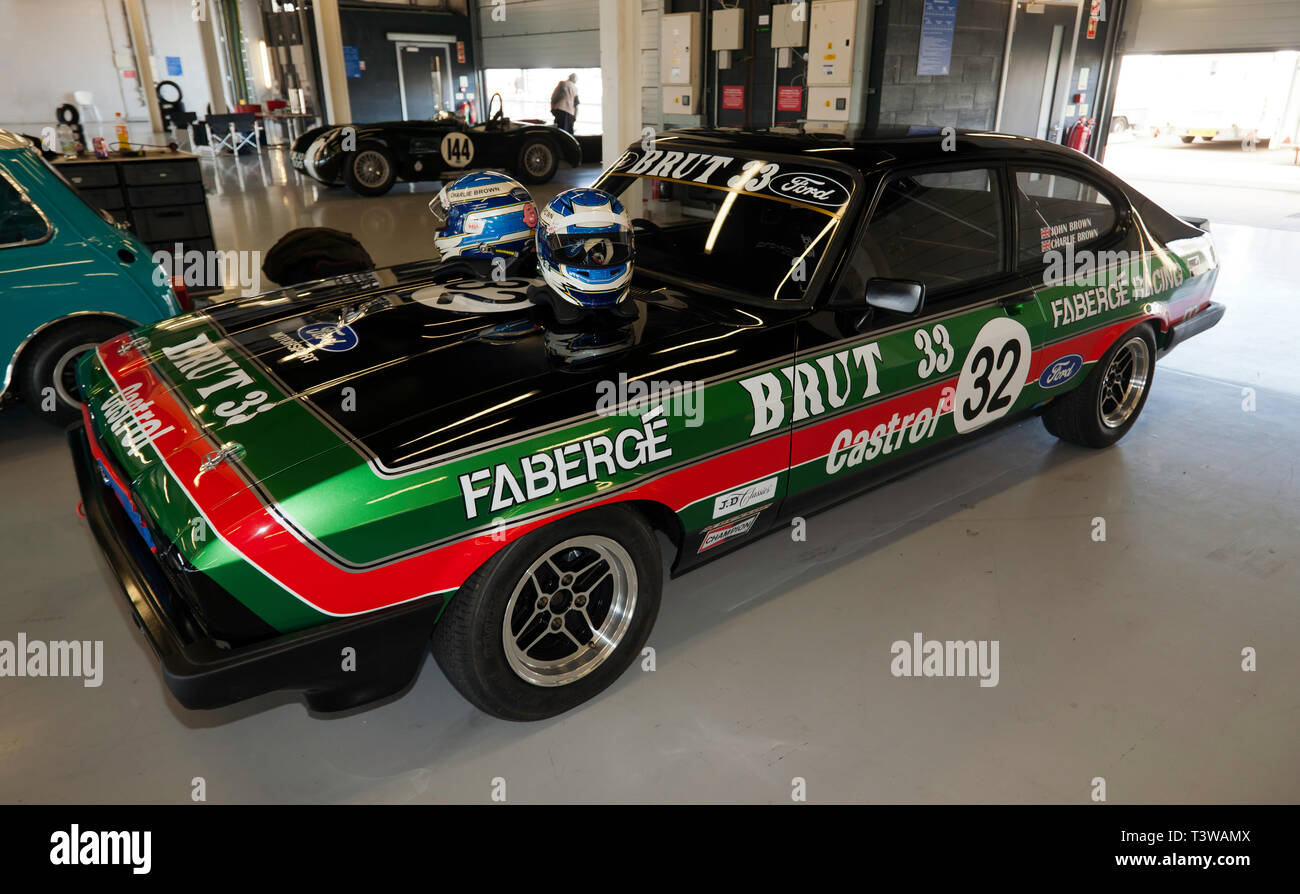 View of a 1980 3L Ford Capri Race Car, owned by John and Charles Brown, in the  International Pits , at the Silverstone Classic Media Day 2019 - Stock Image