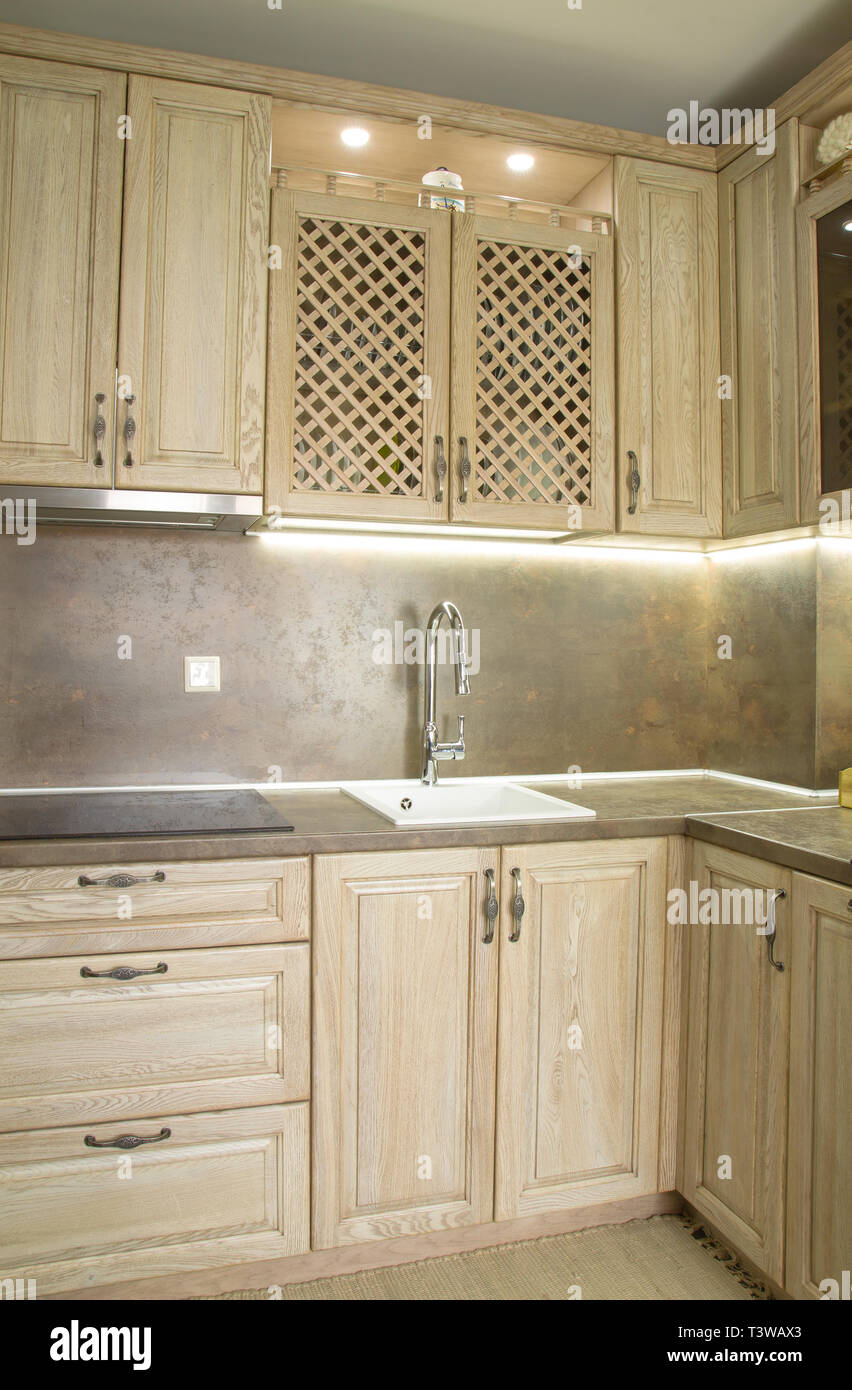 Details of vintage style kitchen furniture in beige brown color