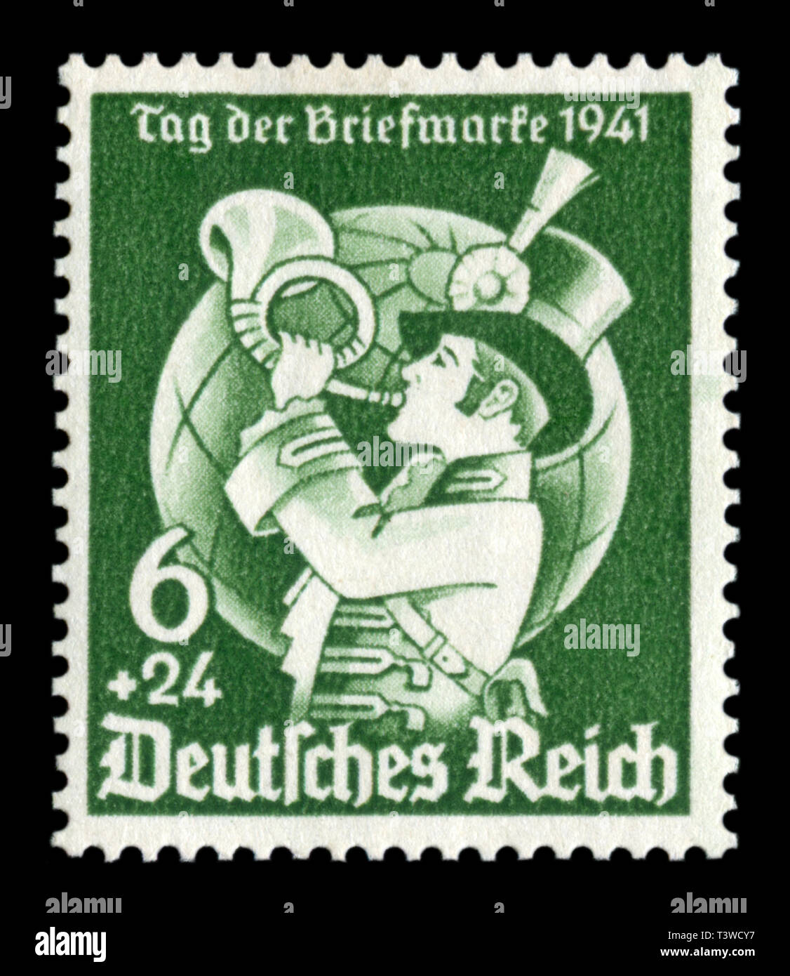German historical stamp: Day of postage stamp, the Postman with a bugle on the background of the globe,  issue 1941, Germany, DR - Stock Image