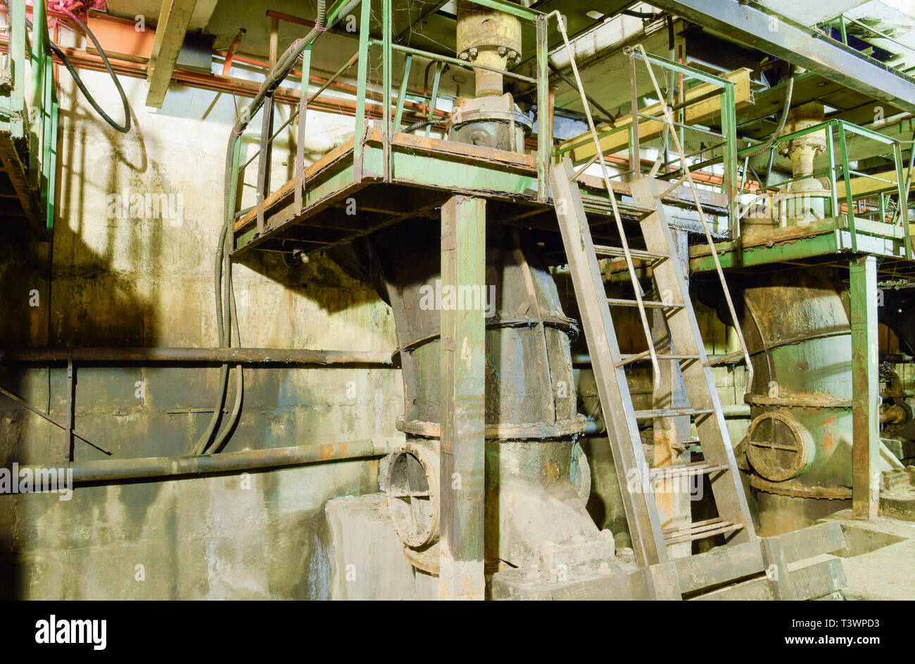 Basement of a water pumping station. Abandoned post-apocalyptic view of the basement pumping rooms. - Stock Image