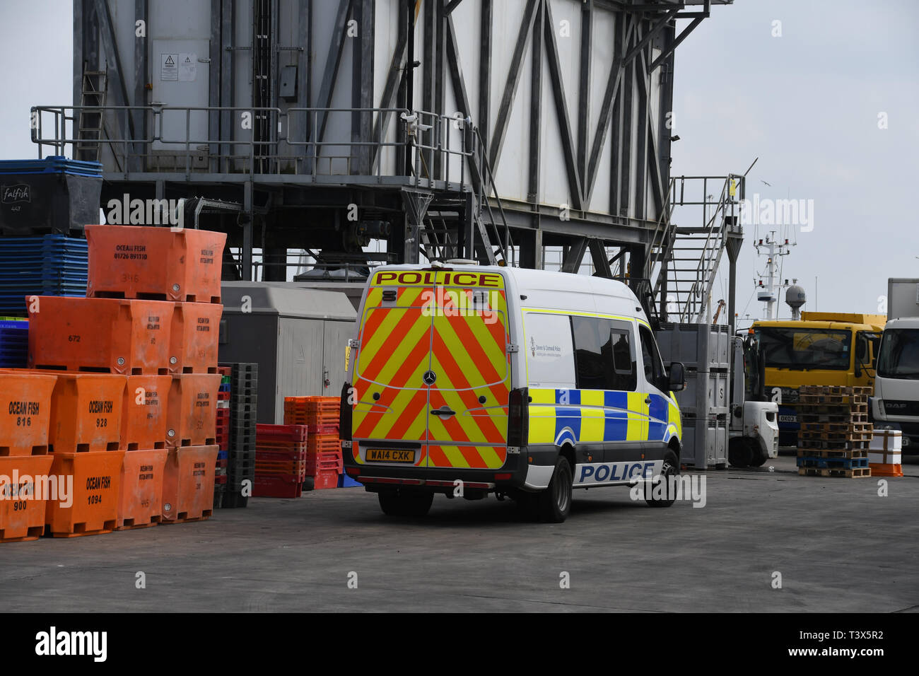 Newlyn, Cornwall, UK. 12th April 2019. Police have made a number of arrests under the modern slavery act at Cullompton after around 30 people were round in the back of a van. They were originally seen getting into the van at Newlyn earlier on this morning. There is still a police prescence at Newlyn harbour - pictured here. Credit: Simon Maycock/Alamy Live News Stock Photo