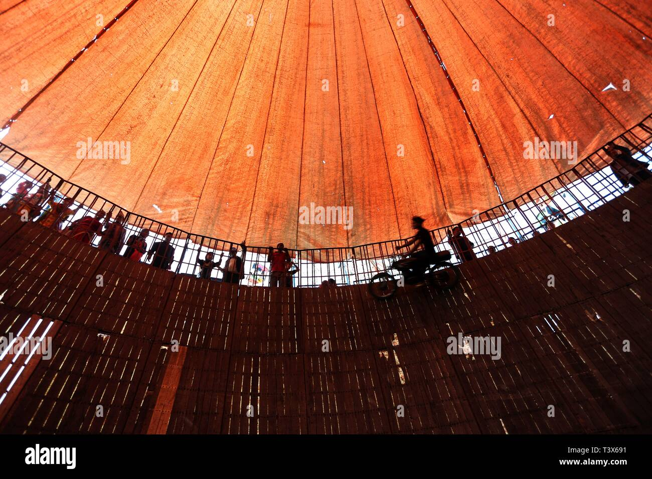 Bhaktapur, Nepal. 12th Apr, 2019. A stuntman performs his skills on his vehicle inside the 'Well of Death' at a fair organized in celebration of Nepali New Year in Bhaktapur, Nepal on April 12, 2019. Credit: Sunil Sharma/Xinhua/Alamy Live News - Stock Image