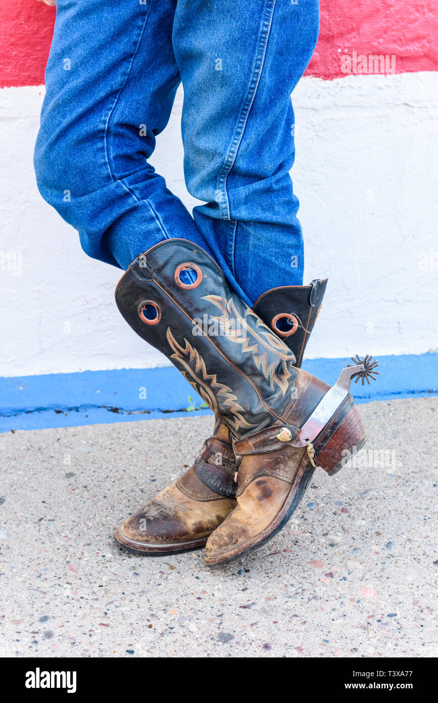 d91ae627048 Old cowboy boots are weathered and brown with stitched design on the ...