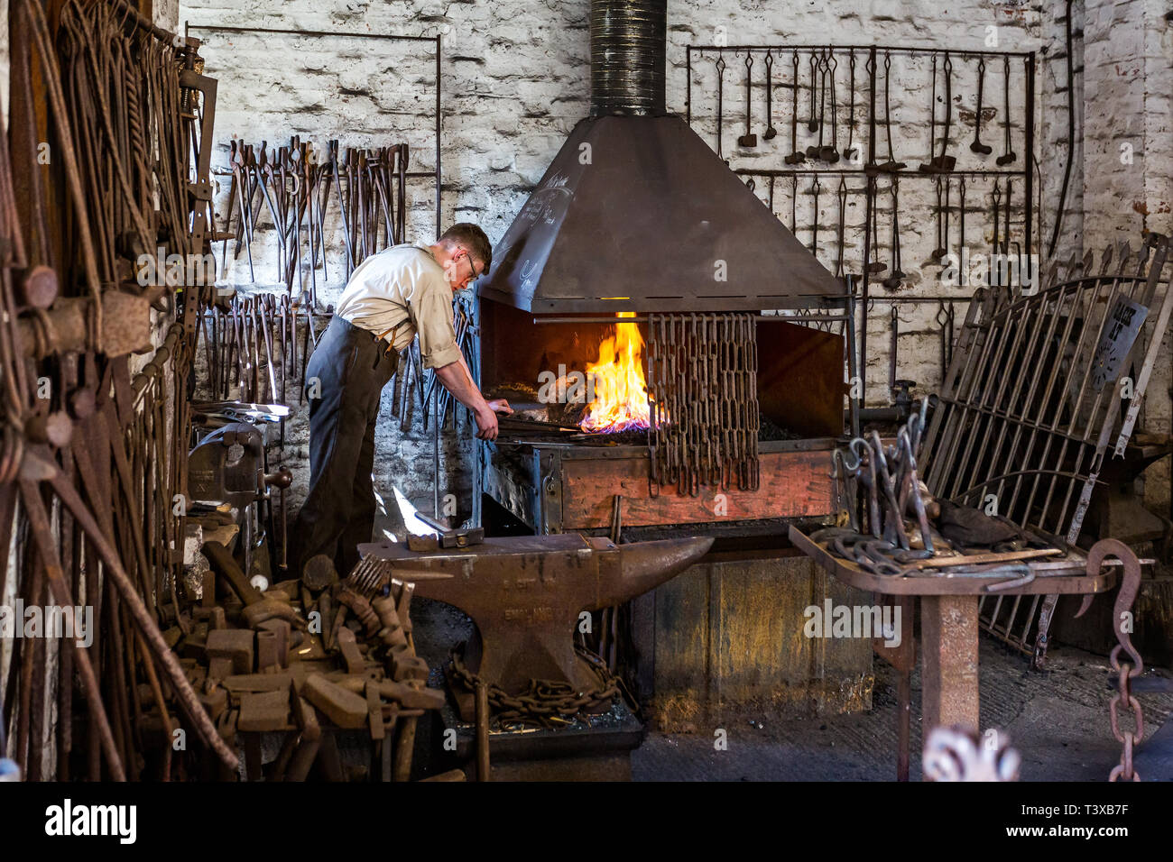 Ironmonger at work with forge and anvil near Telford