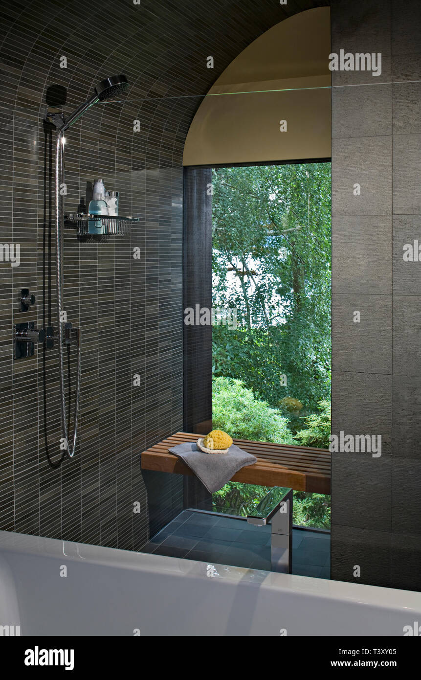 Shower and bench in modern bathroom Stock Photo - Alamy