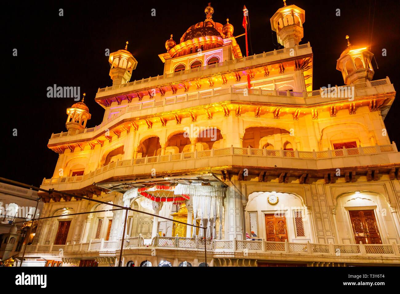 Sri Akal Takhat Sahib in the Golden Temple of Amritsar, the holiest pilgrimage site of Sikhism, Amritsar, Punjab, India, illuminated at night - Stock Image