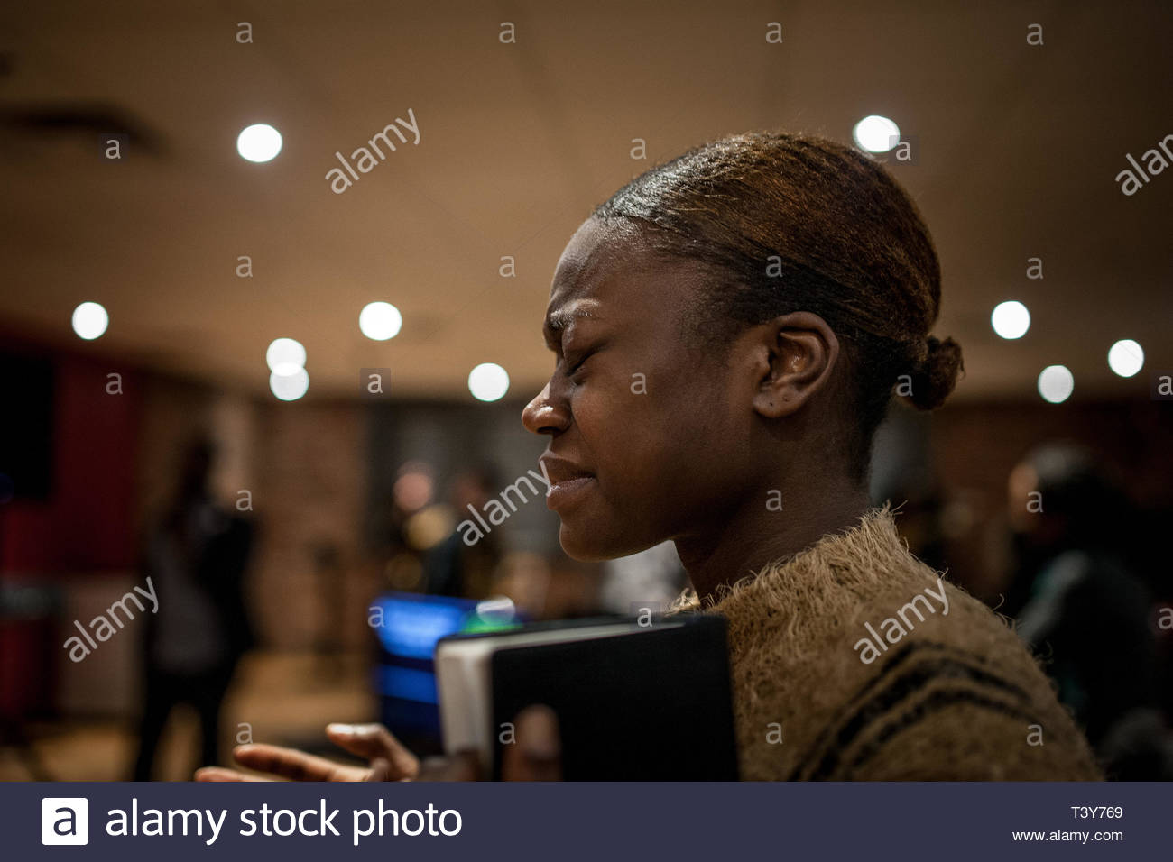January 21, 2018 - Montreal, Quebec, Canada: A woman evangelist grimaces with fervor at a meeting of prayer and worship of God at Evangelist Church. ( - Stock Image