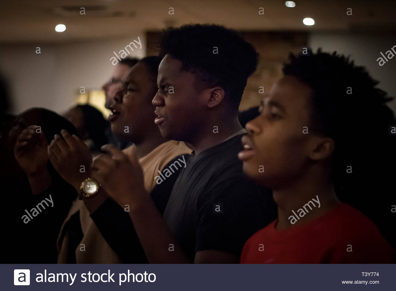January 21, 2018 - Montreal, Quebec, Canada: A young man grimaces with fervor at a meeting of prayer and worship of God at Evangelist Church. (David H - Stock Image