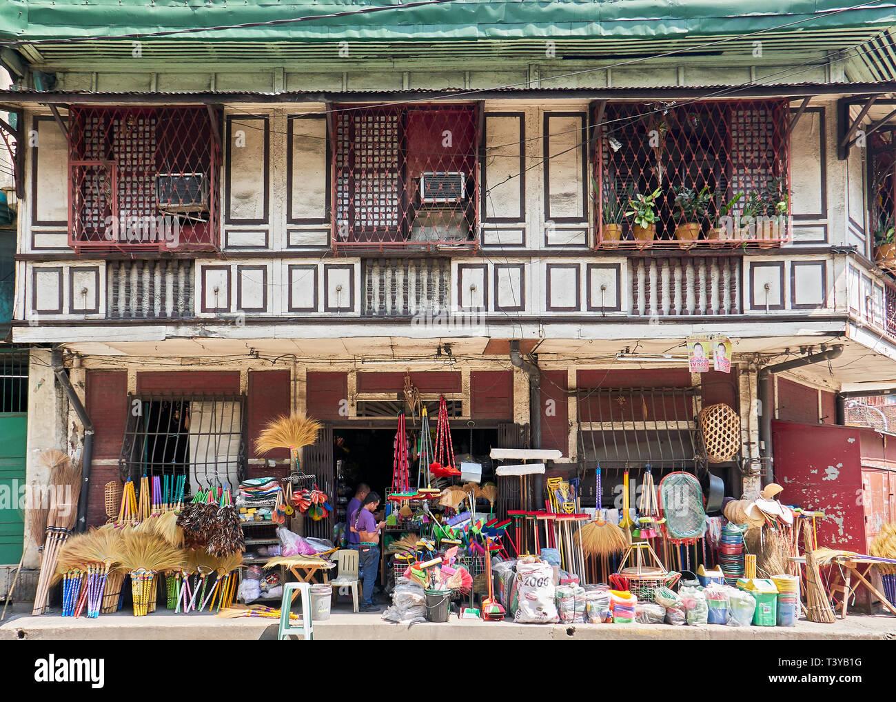 Manila, Philippines: Facade of an old historical wooden building with a shop, Binondo, near the Pasig River, Manila - Stock Image