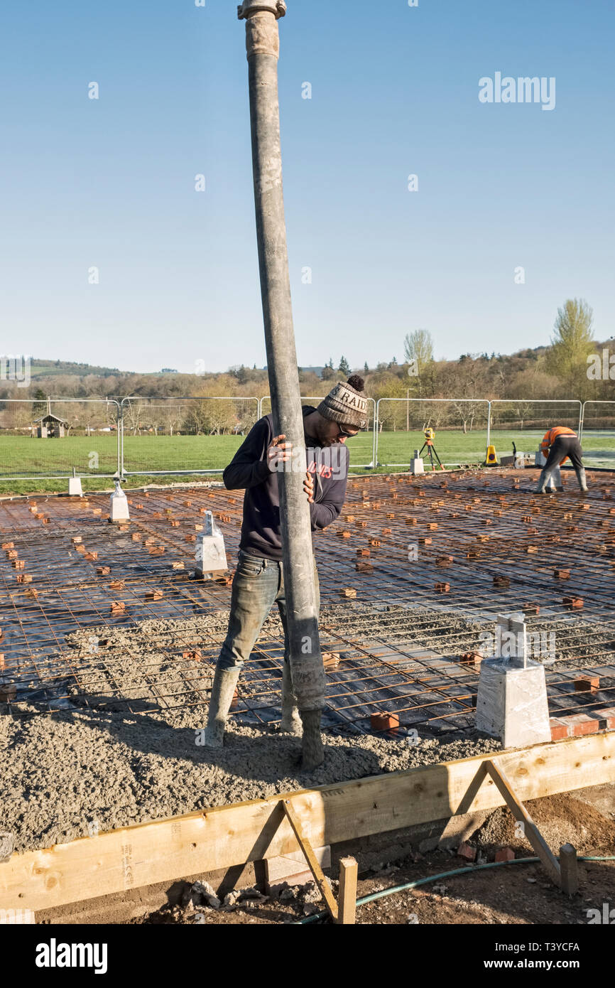 Presteigne, Powys, Wales, UK. Pumping ready mix concrete to form the floor of a new building Stock Photo