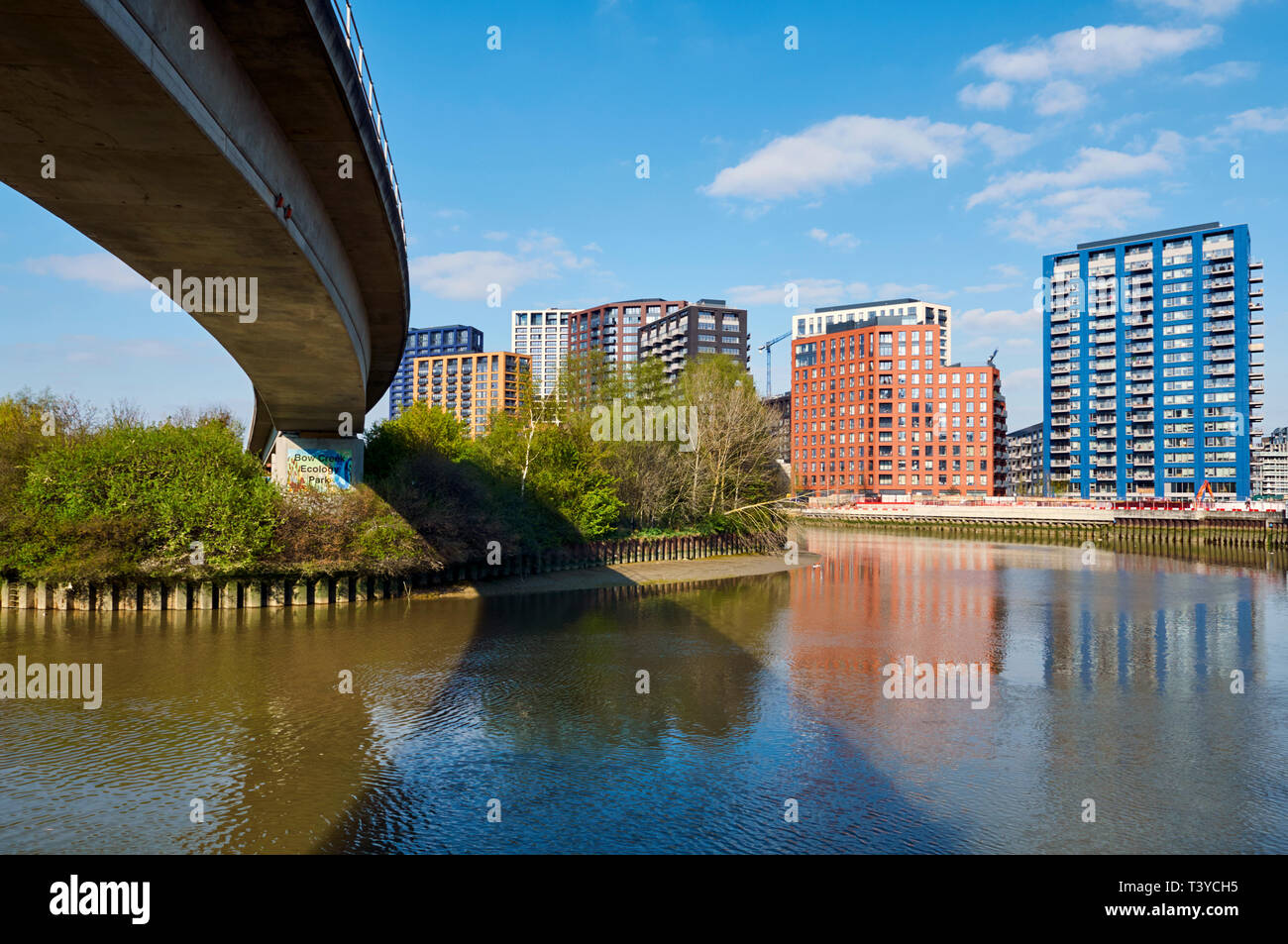 New apartment buildings at Bow Creek, Poplar, London Docklands, UK,  with Bow Creek Ecology Park and the Docklands Light Railway flyover. - Stock Image