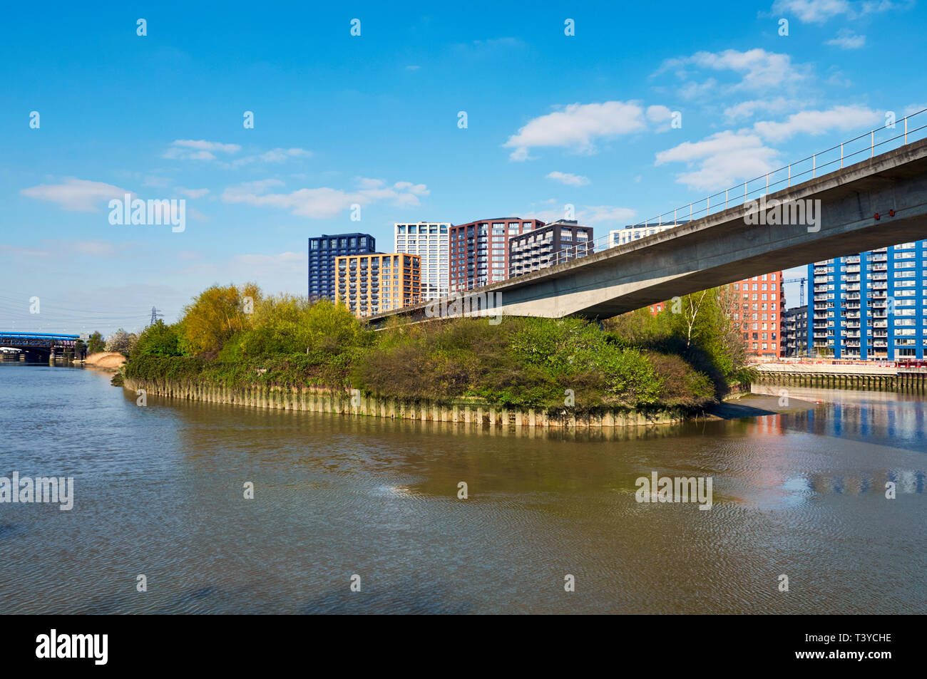 Bow Creek Ecology Park, Poplar, East London UK, with the Docklands Light Railway flyover and new apartments - Stock Image