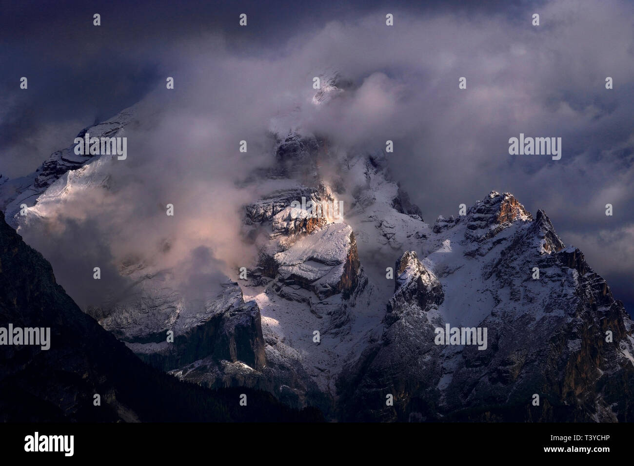 The majesty of Mount Antelao, the highest peak of the region of Cadore, as seen at sunset from the fields surrounding the town of Cortina d'Ampezzo, d - Stock Image