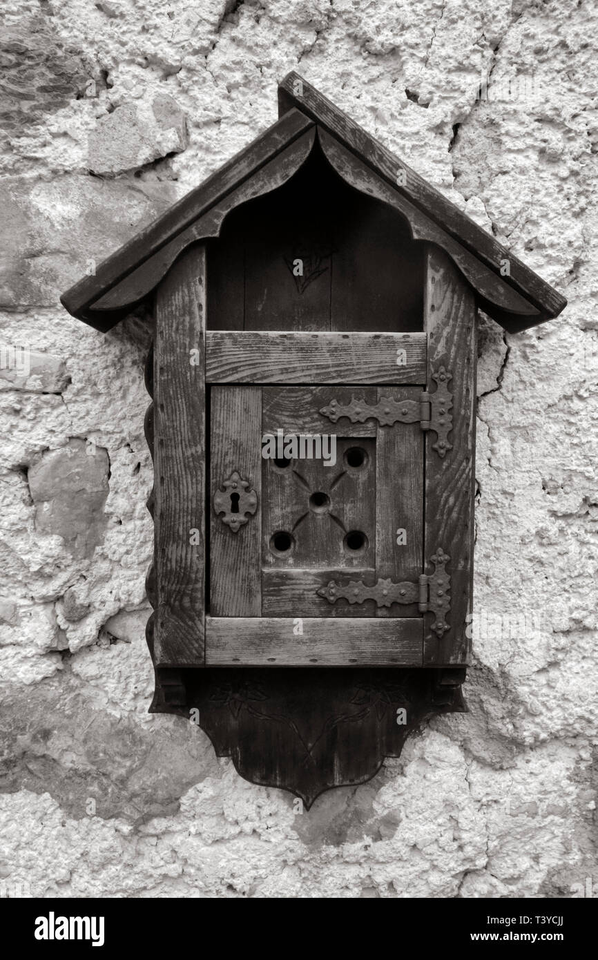 A mail box carved in wood in the typical mountain style of the Dolomites. Taken in Cortina d'Ampezzo, Veneto, Italy - Stock Image