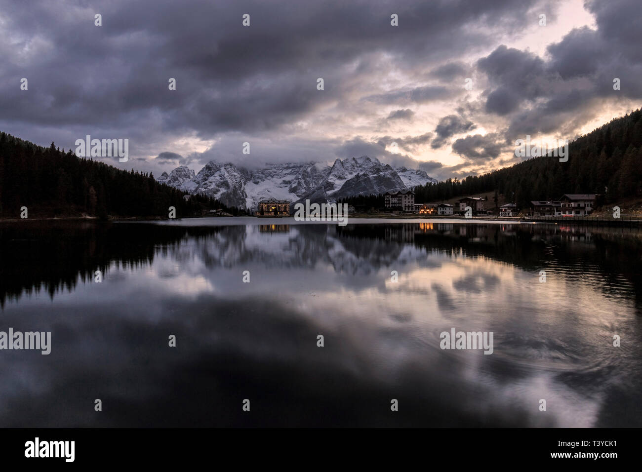 A beautiful view at dusk of the Lake of Misurina, a lake in the Dolomiti d'Ampezzo, not far from the town of Cortina. Taken about 30 minutes after sun - Stock Image