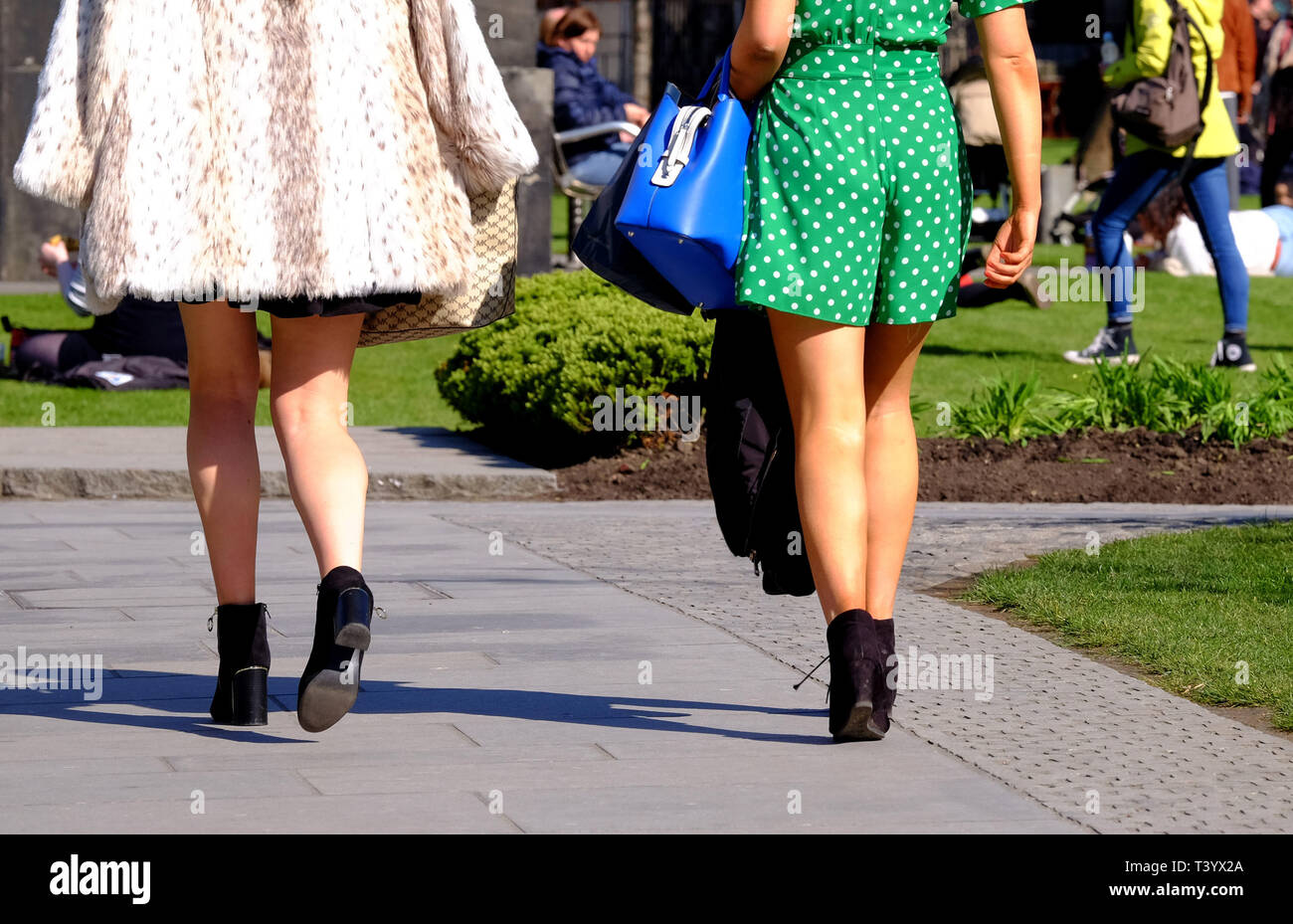 b9b72cb8ed Two women wearing short skirts walk in the sunshine as upskirting, the  invasive practice of taking an image or video up somebody???s clothing, ...
