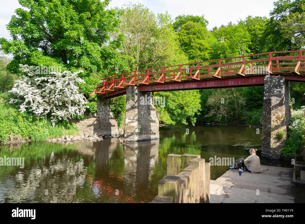 The Red Bridge spans the lagan beside a restored lock. - Stock Image