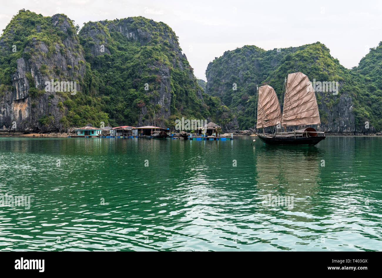 Traditional old junk boat near floating village in Ha Long Bay, Vietnam - Stock Image