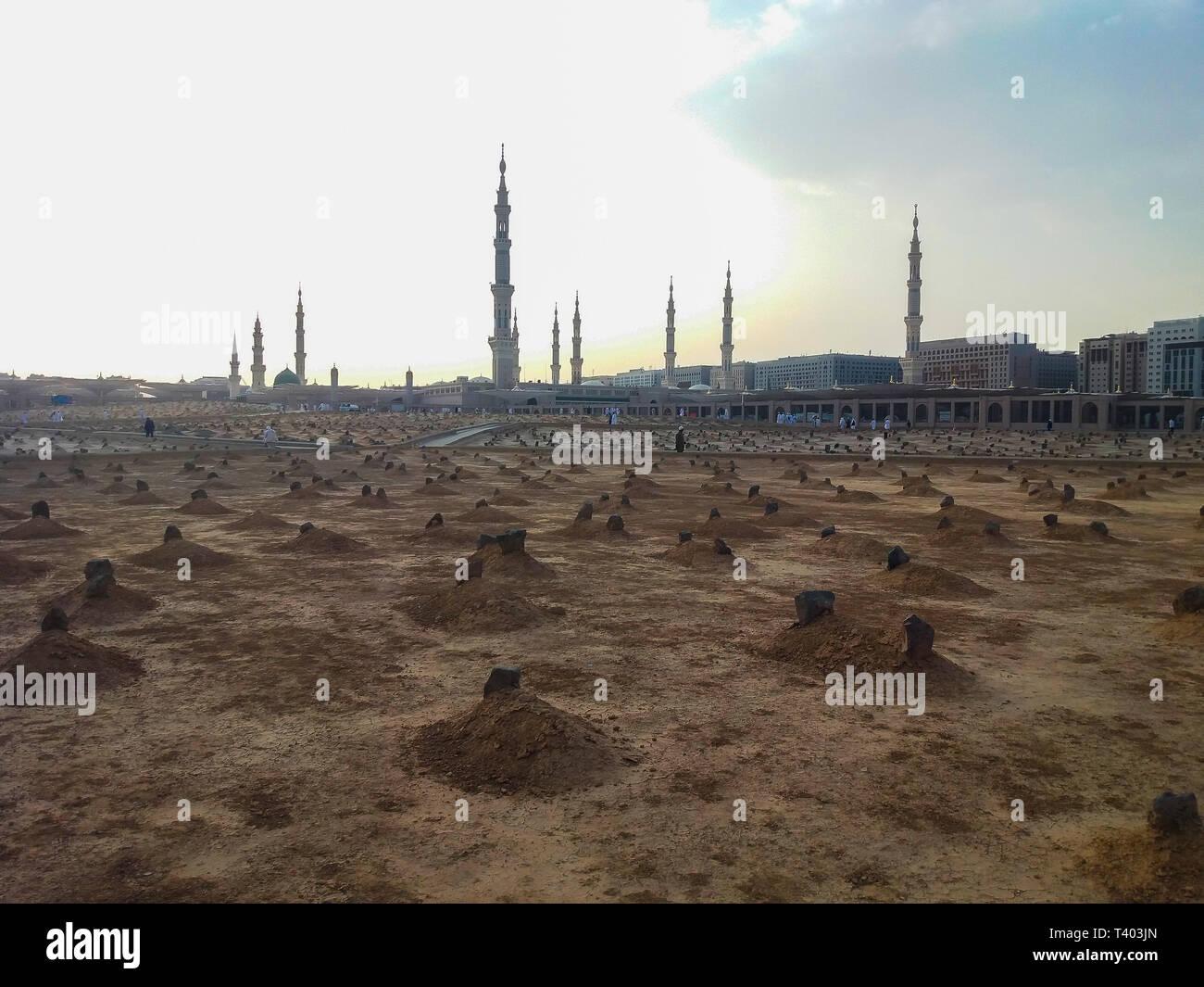 Madinah, Saudi Arabia march 2019, Muslims at Prophet Muhammad's mosque square in Madinah Al-Munawarrah. View of Baqee` Muslim cemetary at Masjid mosqu - Stock Image