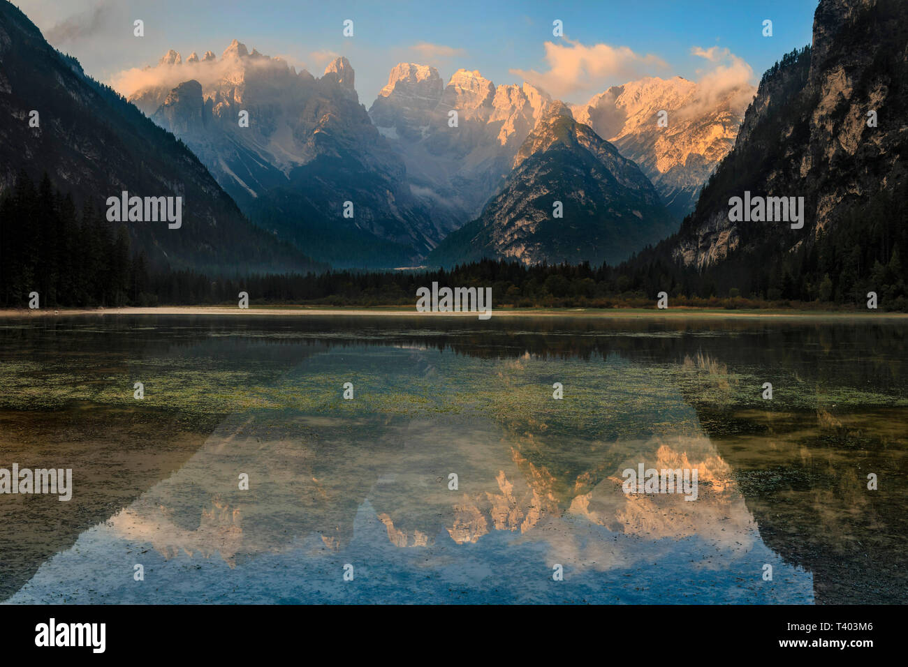 A gorgeous sunrise at Lake Landro. The perfectly still waters of the Lake Landro at sunrise made for a wonderful mirrored image of the Cristallo Group - Stock Image