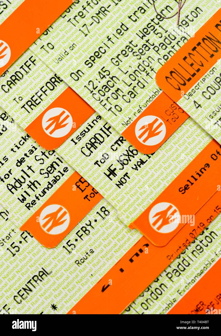 CARDIFF, WALES - APRIL 2019: Close up view of traditional printed rail tickets with the National Rail logo. - Stock Image