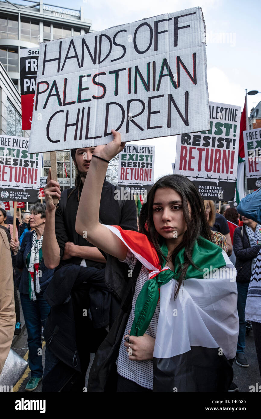 Rally for Palestine outside the Israeli Embassy: Exist,Resist, Return. A global call for solidarity on the 1st anniversary of the start of the Great Return March. - Stock Image
