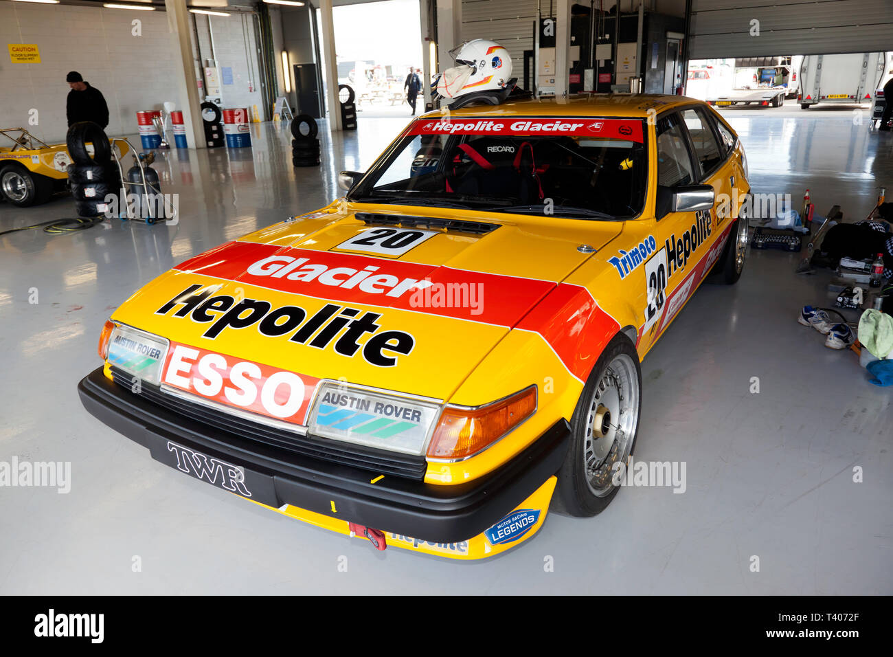 Ken Clarke's  1983 Yellow and Red Rover SD1 Vitesse  Historic Touring Car, in the International Pit Garage at the 2019 Silverstone Classic Media Day - Stock Image
