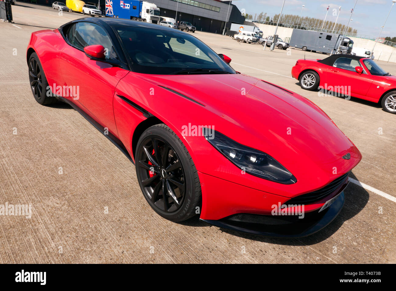 An Red Aston Martin Db11 Parked In The International Paddock During The 2019 Silverstone Classic Media Day Stock Photo Alamy