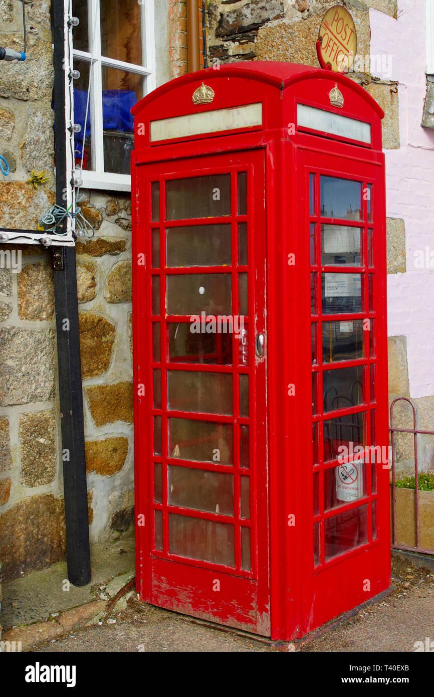 Red Telephone Box, Mousehole, Cornwall, England. - Stock Image