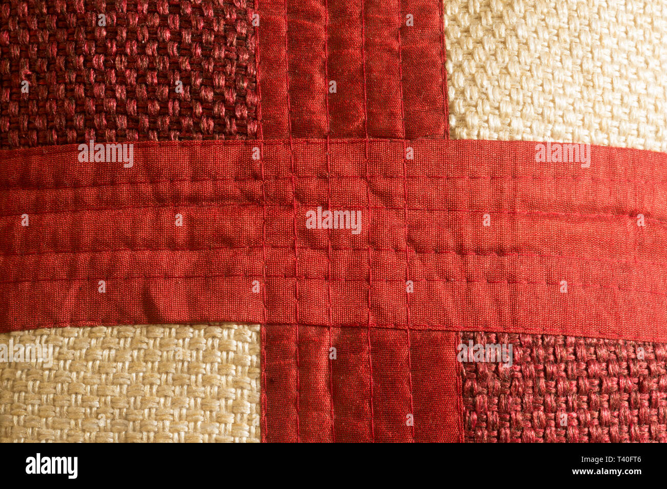 Close up Abstract of silk or satin fabric background of linen cloth textile of red fabric with crisscross diagonal pattern for any occasion. Natural c - Stock Image