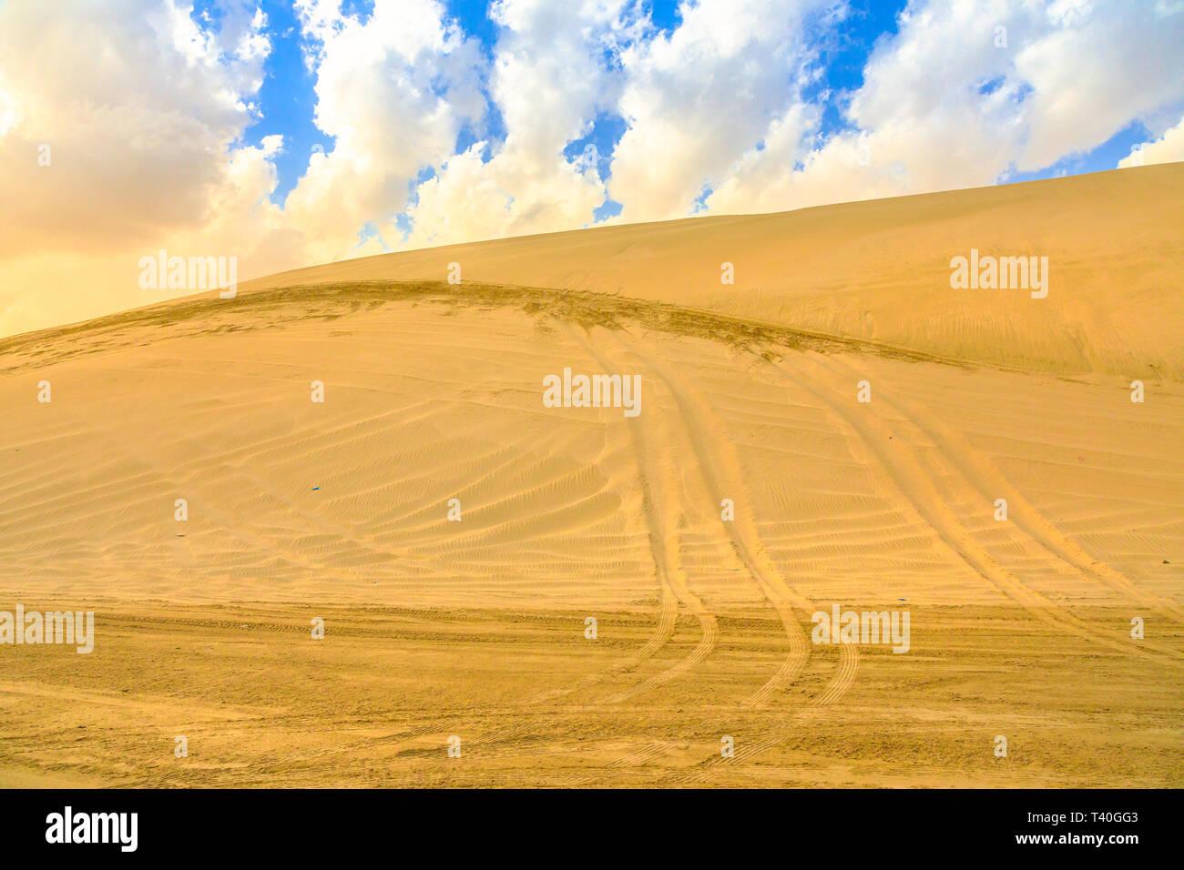 Desert safari adventure at Khor Al Udeid, Persian Gulf, Middle East. Desert landscape sand dunes near Qatar and Saudi Arabia. Inland sea is a major to - Stock Image