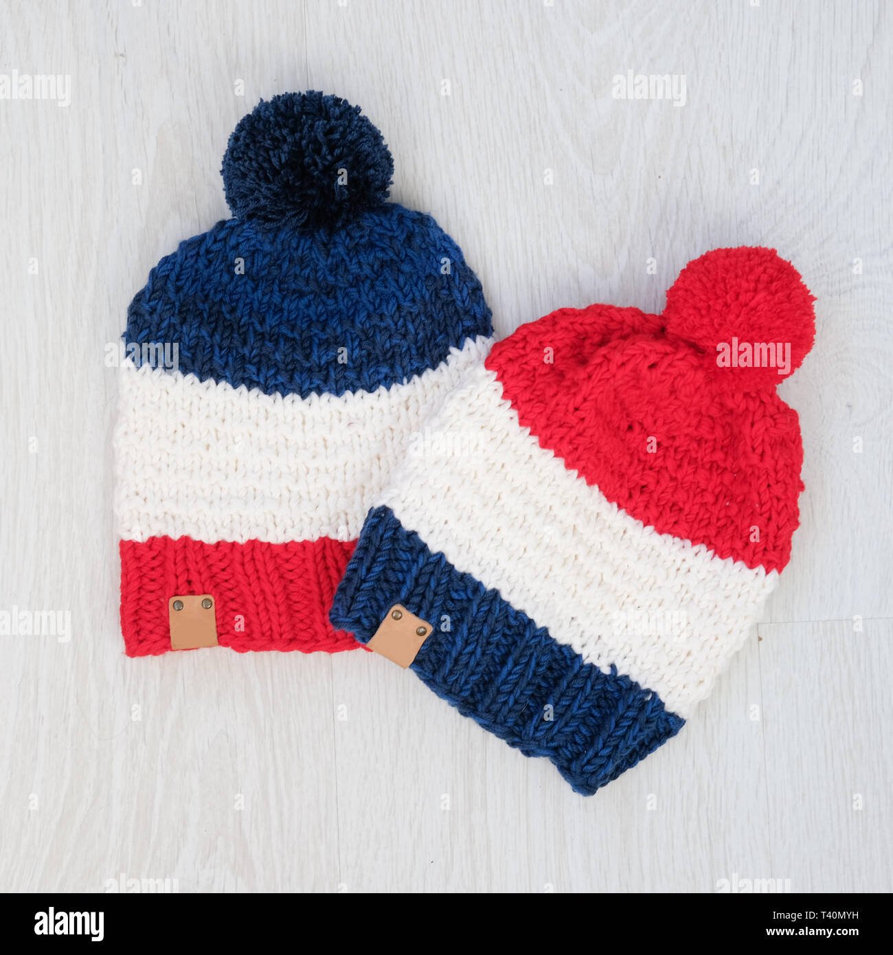 20ac0485428 cute cozy knitted children set of navy red hats - Stock Image