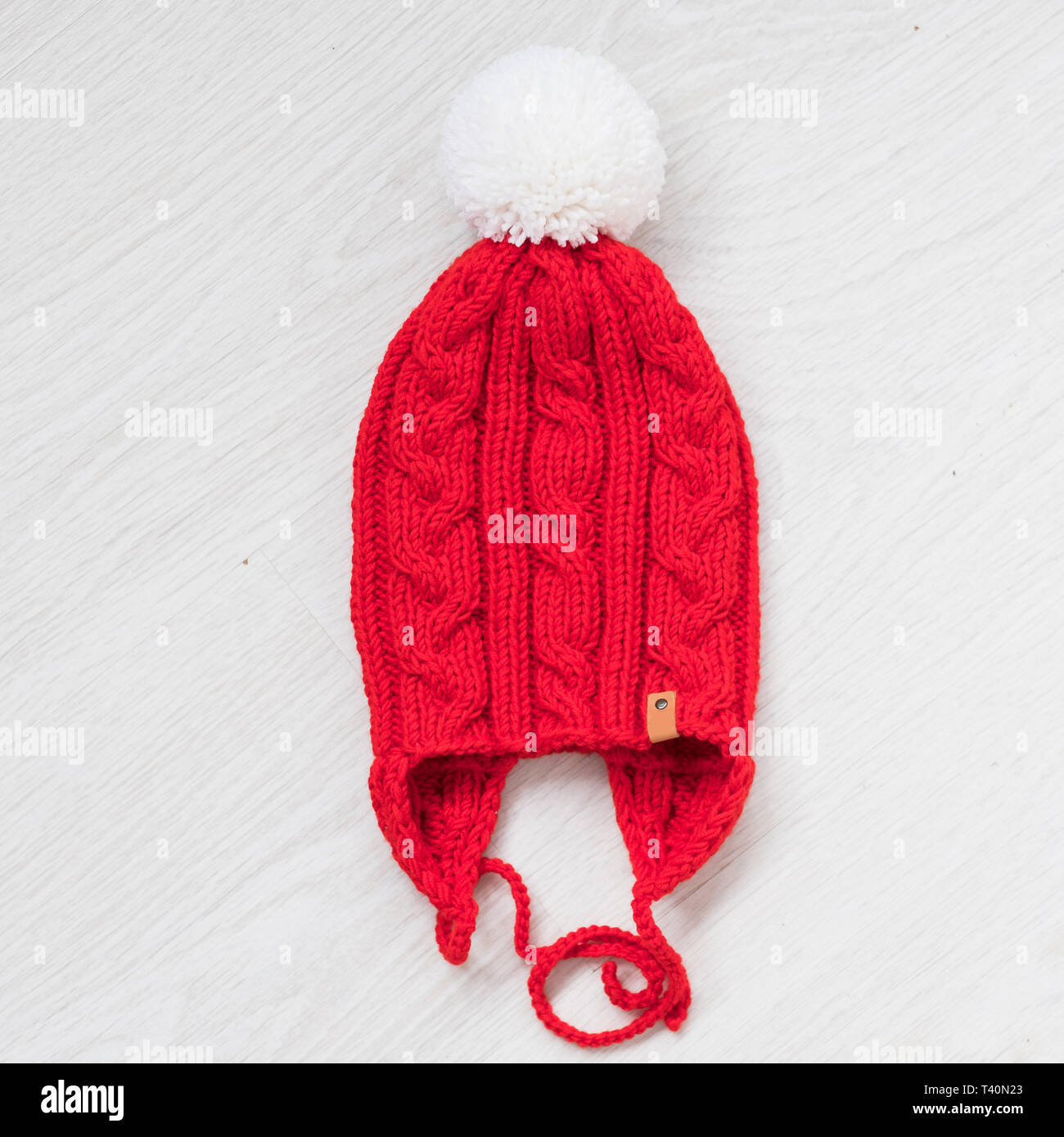 0f757018fa4 cute cozy knitted children winter red hat - Stock Image