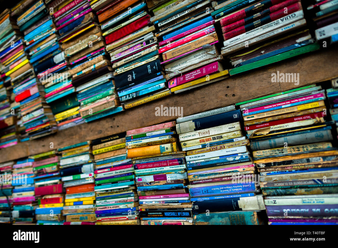Spines of used books are seen stacked in a secondhand bookshop in San Salvador, El Salvador. Stock Photo