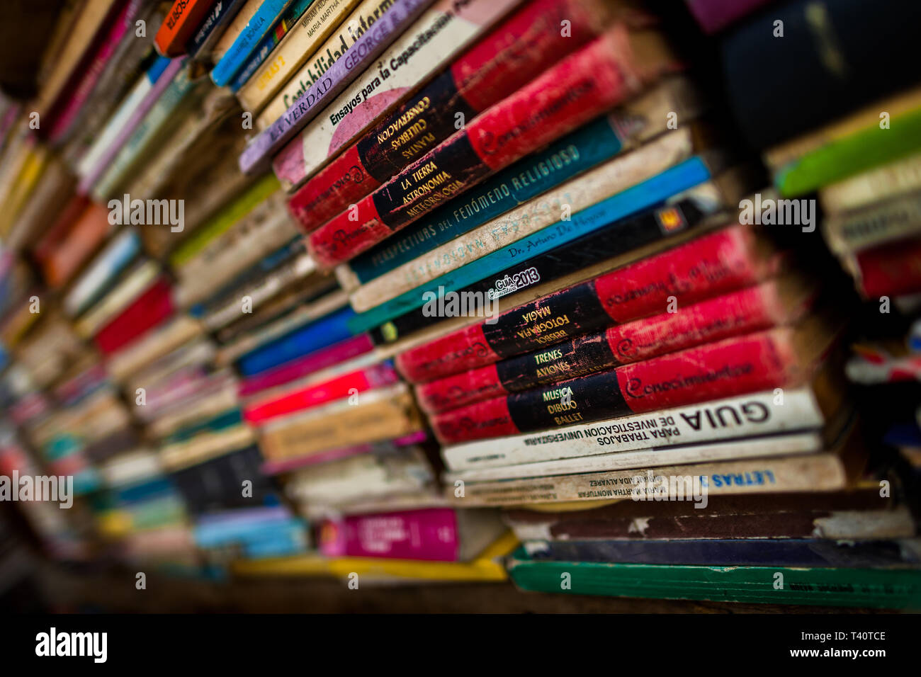 Spines of used books are seen stacked in a secondhand bookshop in San Salvador, El Salvador. - Stock Image